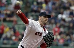 Boston Red Sox's John Lackey delivers a pitch against the Oakland Athletics in the first inning of a baseball game on Sunday, May 4, 2014, in Boston. (AP Photo/Steven Senne)