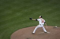 Baltimore Orioles starting pitcher Kevin Gausman throws to the Minnesota Twins in the third inning of a baseball game, Monday, Sept. 1, 2014, in Baltimore. (AP Photo/Patrick Semansky)