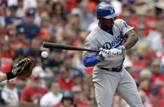 A ball bounces off the left hand of Los Angeles Dodgers' Yasiel Puig during the third inning of a baseball game against the St. Louis Cardinals Saturday, July 19, 2014, in St. Louis. Puig left the game in the eighth inning and the Cardinals went on to win 4-2. (AP Photo/Jeff Roberson)