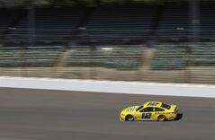 Driver Juan Pablo Montoya practices for the Brickyard 400 Sprint Cup series auto race at the Indianapolis Motor Speedway in Indianapolis, Friday, July 25, 2014. (AP Photo/Darron Cummings)