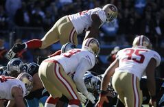 San Francisco 49ers outside linebacker Ahmad Brooks (55) jumps off sides against the Carolina Panthers during the first half of a divisional playoff NFL football game, Sunday, Jan. 12, 2014, in Charlotte, N.C. (AP Photo/John Bazemore)