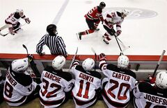 Members of the New Jersey Devils sit on the bench while watching an NHL hockey scrimmage against the Albany Devils, the team's AHL affiliate, Wednesday, Jan. 16, 2013, in Newark, N.J. (AP Photo/Julio Cortez)