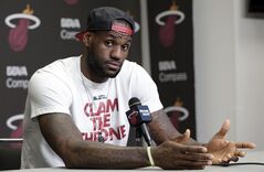 FILE - In this June 17, 2014 file photo, Miami Heat's LeBron James gestures as he answers a question during a news conference in Miami. A person familiar with the situation tells The Associated Press that James has decided to opt out of the final two years of his contract with the Heat and become a free agent on July 1. Opting out does not mean James has decided to leave the Heat, said the person, who spoke on condition of anonymity because neither the four-time NBA MVP nor the team had made any public announcement. (AP Photo/Alan Diaz, File)