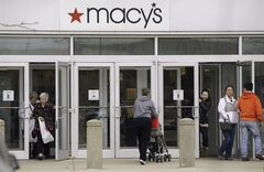 In this April 29, 2014 photo, shoppers enter and leave a Macy's department store in Braintree, Mass. Macy's reports quarterly earnings on Wednesday, May 14, 2014. (AP Photo/Stephan Savoia)