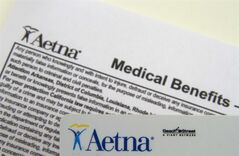 FILE - This Jan. 30, 2012 file photo, an Aetna benefits card is photographed in Surfside, Fla. Aetna reports quarterly earnings on Thursday, April 24, 2014. (AP Photo/Wilfredo Lee, File)