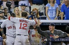 Boston Red Sox's Mike Napoli (12) is greeted by coaches and teammates after hitting a solo home run against the New York Yankees in the ninth inning of a baseball game, Saturday, June 28, 2014, in New York. The Red Sox won 2-1. (AP Photo/Julie Jacobson)