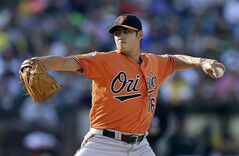 Baltimore Orioles' Wei-Yin Chen works against the Oakland Athletics in the first inning of a baseball game Saturday, July 19, 2014, in Oakland, Calif. (AP Photo/Ben Margot)