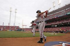 Washington Nationals' Denard Span (2) and Anthony Rendon (6) prepare on deck at the beginning of a baseball game against the Cincinnati Reds, Friday, July 25, 2014, in Cincinnati. (AP Photo/David Kohl)