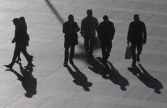 Office workers walk in the business district of Madrid, Tuesday Jan. 15, 2013. Spain has sold an above-target euro 5.8 billion ($7.74 billion) in short-term bills at a sharply reduced interest rate, reflecting easing investor concern over the country's ability to manage its finances without a bailout. Spain's borrowing costs have plunged from unsustainable highs last year after the European Central Bank pledged to help countries by buying up their short-term bonds if they apply for help. Spain says it does not need outside aid for the moment.(AP Photo/Paul White)