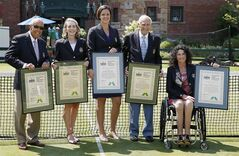 The 2014 inductees into the International Tennis Hall of Fame, from left, Nick Bollettieri, Jane Brown Grimes, Lindsay Davenport, John Barrett and Chantal Vandierendonck pose for photographs after being enshrined in Newport, R.I., Saturday, July 12, 2014. (AP Photo/Michael Dwyer)