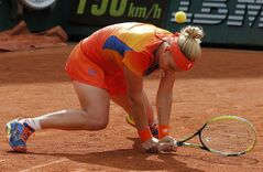 Russia's Svetlana Kuznetsova falls as she plays Romania's Simona Halep during their quarterfinal match of the French Open tennis tournament at the Roland Garros stadium, in Paris, France, Wednesday, June 4, 2014. (AP Photo/Michel Spingler)