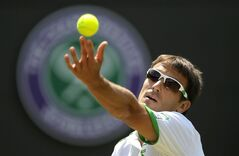 Tommy Robredo of Spain serves to Roger Federer of Switzerland during their men's singles match at the All England Lawn Tennis Championships in Wimbledon, London, Tuesday July 1, 2014. (AP Photo/Pavel Golovkin)