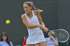Bojana Jovanovski of Serbia plays a return to Victoria Azarenka of Belarus during their women's singles match at the All England Lawn Tennis Championships in Wimbledon, London, Wednesday, June 25, 2014. (AP Photo/Pavel Golovkin)