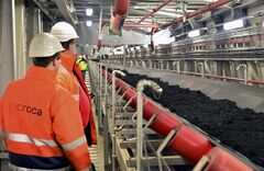 ADVANCE FOR MONDAY, JULY 28, 2014, AT 12:01 A.M. AND THEREAFTER - This image provided by Trianel on July 24, 2013, shows workers watching coal being transported in the Trianel power plant in Luenen, western Germany. The 750-megawatt Trianel power plant relies completely on coal imports, about half from the U.S. Soon, all of Germany's coal-fired power plants will be dependent on imports, with the country scheduled to halt all coal mining in 2018 when government subsidies end. Coal mining's demise in Germany comes as the country is experiencing a resurgence in coal-fired power, one which the U.S. increasingly has helped supply. (AP Photo/Trianel, Guenther Goldstein)