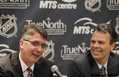 Kevin Cheveldayoff (right) says one of his most important moves was to hire Claude Noel as head coach.