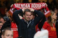 Liverpool supporters react as their team applaud them following the end of the English Premier League soccer match between Crystal Palace and Liverpool at Selhurst Park stadium in London, Monday, May 5, 2014. The match ended in a 3-3 draw. (AP Photo/Alastair Grant)