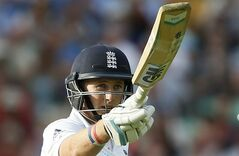 England's Joe Root celebrates getting 50 runs not out during the second day of the fifth test cricket match against India at Oval cricket ground in London, Saturday, Aug. 16, 2014. (AP Photo/Alastair Grant)