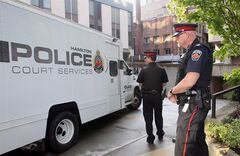 A prisoner van carrying accused Dellen Millard enters the courthouse on May 15 2013 in Hamilton, Ont. THE CANADIAN PRESS//Dave Chidley