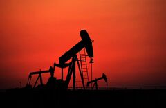 Oil pumps work at sunset on Sept. 11, 2013, in the desert oil fields of Sakhir, Bahrain. THE CANADIAN PRESS/AP, Hasan Jamali