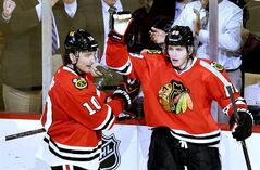 Chicago Blackhawks left wing Patrick Sharp, left, and right wing Patrick Kane celebrate Kane's goal during the third period of an NHL hockey game against the Minnesota Wild, Tuesday, March 5, 2013 in Chicago. The Blackhawks won 5-3. (AP Photo/Brian Kersey)