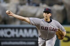 Cleveland Indians starting pitcher Justin Masterson throws to the Los Angeles Angels during the first inning of a baseball game in Anaheim, Calif., Monday, April 28, 2014. (AP Photo/Chris Carlson)