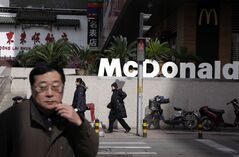 Residents walk by a McDonald's restaurant in an area off limits to foreign journalists, in Beijing, China, March 1, 2011.THE CANADIAN PRESS/AP, Ng Han Guan