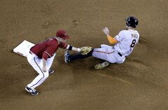 Arizona Diamondbacks' Aaron Hill tags out San Francisco Giants' Hunter Pence (8) on a steal attempt during the fourth inning of a baseball game, Sunday, June 22, 2014, in Phoenix. (AP Photo/Matt York)