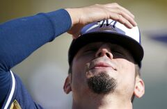 Milwaukee Brewers' Matt Garza exhales as he adjusts his hat during spring training baseball practice, Monday, Feb. 17, 2014, in Phoenix. (AP Photo/Ross D. Franklin)