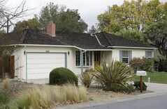 This photo shows 2066 Crist Drive, the home where Steve Jobs grew up, in Los Altos, Calif., Tuesday, Oct. 29, 2013. The Silicon Valley home where Apple co-founder�Steve�Jobs�grew up and built some of his first computers is now on the city's list of historic properties. The historical commission in the city of Los Altos voted unanimously for the historic designation on Monday night, the Palo Alto Daily News reported. (AP Photo/Jeff Chiu)