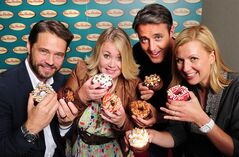 Jason Priestley, left to right, Jann Arden, Ben Mulroney and Anna Olson pose with donuts in this undated handout photo. After an intense afternoon of eating sweet snacks the judges have chosen four finalists in the Tim Hortons Duelling Doughnuts contest. THE CANADIAN PRESS/HO-Greig Reekie