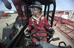 Renee Jones, first year apprentice crane operator, is seen on a RT 65 ton crane which she operates at Mammoet, in Edmonton Alta., on May 9, 2012. Jones got her start in the Women Building Futures program. THE CANADIAN PRESS/Jason Franson