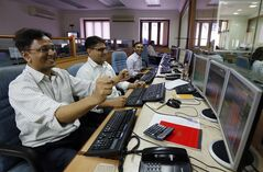 Indian stockbrokers celebrate as they watch the Bombay Stock Exchange (BSE) index on their trading terminal in Mumbai, India, Tuesday, May 13, 2014. India's stock market and currency rallied Tuesday on exit polls predicting election victory for a pro-business party and its allies. The Sensex stock index rose above 24,000 for the first time, gaining more than 2 percent before paring its gain. The dollar, meanwhile, fell to 59.60 rupees from 60.05 rupees on Monday. (AP Photo/Rajanish Kakade)