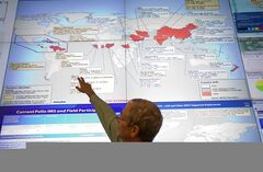 Steve Monroe, deputy director of the National Center for Emerging and Zoonotic Infectious Diseases at the U.S. Centers for Disease Control and Prevention, looks over a map showing global health issues under the agency's surveillance from their Emergency Operations Center, Tuesday, Aug. 5, 2014, in Atlanta. An American aid worker infected with Ebola arrived Tuesday from Liberia to Emory University Hospital, just downhill from the CDC, joining a second patient being given an experimental treatment that has never before been tested on humans. (AP Photo/David Goldman)