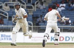 New Zealand's batting partners Ross Taylor, left, and Kane Williamson run between the wickets during the opening day of their first cricket Test match against West Indies in Kingston, Jamaica, Sunday, June 8, 2014. (AP Photo/Arnulfo Franco)