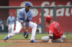 Los Angeles Angels' Albert Pujols (5) beats the tag by Kansas City Royals shortstop Alcides Escobar to advance to second on a wild pitch by Yordano Ventura during the third inning of a baseball game Saturday, June 28, 2014, in Kansas City, Mo. (AP Photo/Charlie Riedel)