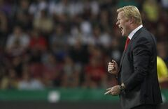 FILE - This is a Thursday, Aug. 30, 2012 a file photo of the then Feyenoord head coach Ronald Koeman as he reacts during the second leg Europa League play off soccer match against Sparta Prague in Prague, Czech Republic. Koeman is the new coach of the English Premier League team Southampton. The new English Premier League season starts on Saturday Aug. 16, 2014. (AP Photo/Petr David Josek)