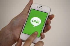 A smart phone is shown with messaging app Line in Seoul, South Korea, Wednesday, July 16, 2014. Naver Corp. said its subsidiary Line Corp. that operates a popular mobile messaging app is considering listing its shares in Tokyo or New York. Naver, South Korea's largest Internet company, said Wednesday that Line could sell shares in an initial public offering in both Japan and the U.S. (AP Photo/Lee Jin-man)