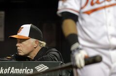 Baltimore Orioles manager Buck Showalter watches from the dugout in the ninth inning of a baseball game against the Tampa Bay Rays, Wednesday, Aug. 27, 2014, in Baltimore. Tampa Bay won 3-1. (AP Photo/Patrick Semansky)