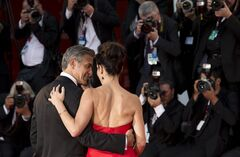 AP10ThingsToSee - Actors George Clooney, left, and Sandra Bullock pose for photographers as they arrive for the screening of Gravity at the 70th edition of the Venice Film Festival held from Aug. 28 through Sept. 7, in Venice, Italy, Wednesday, Aug. 28, 2013. (AP Photo/David Azia, File)