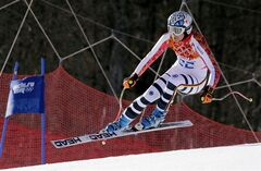 Germany's Maria Hoefl-Riesch makes a jump in the women's super-G at the Sochi 2014 Winter Olympics, Saturday, Feb. 15, 2014, in Krasnaya Polyana, Russia. (AP Photo/Charles Krupa)
