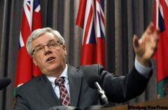 Manitoba Premier Greg Selinger answers reporters' questions after the government announced Tuesday a $175-million program to compensate those hit by this year's flood and then flood-proof communities along the Assiniboine River and Lake Manitoba.