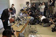 FILE - In this Thursday, Jan. 31, 2013 file photo, Japanese women's judo national team head coach Ryuji Sonoda bows before a press conference in Tokyo. Sonoda resigned over accusations he physically abused female judoka at a training camp before the London Olympics. Just when Tokyo was getting a boost in its bid to host the 2020 Olympics, this ugly scandal has surfaced within the Japanese sporting culture and threatened to undermine the nation's hosting hopes. (AP Photo/Shizuo Kambayashi, File)