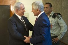 Israeli Prime Minister Benjamin Netanyahu, left, welcomes U.S. Secretary of Defense Chuck Hagel at his office in Jerusalem, on Tuesday, April 23, 2013. Hagel said the U.S. and Israel need to ensure that their alliance is