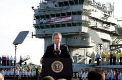In this May 1, 2003 file photo, President George W. Bush speaks aboard the aircraft carrier USS Abraham Lincoln off the California coast with the infamous 'Mission accomplished' banner.