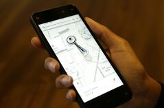 The map app on new Amazon Fire Phone is demonstrated on Wednesday, June 18, 2014, in Seattle. The map app includes 3D-like renderings of buildings such as the Space Needle. (AP Photo/Ted S. Warren)