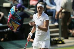 Petra Kvitova of Czech Republic throws a towel to a ball boy during her women's singles semifinal match against Lucie Safarova of Czech Republic at the All England Lawn Tennis Championships in Wimbledon, London, Thursday, July 3, 2014. (AP Photo/Pavel Golovkin)