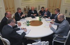 Energy Commissioner Guenter Oettinger, third left, talks with Ukrainian Prime Minister Arseniy Yatsenyuk, right, and his Ministers at a round table discussion in the Ukrainian Cabinet in Kiev, Ukraine, early hours of Sunday, June 15, 2014. (AP Photo/Andrew Kravchenko, Pool)