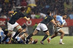 Argentina's Martin Landajo, right, avoids a tackle from South Africa's Ruan Pienaar, second left, during their Rugby Championship match at Loftus Versfeld stadium in Pretoria, South Africa, Saturday, Aug. 16, 2014. (AP Photo/Themba Hadebe)