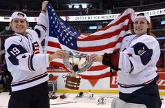 Team USA players Gigi Marvin(left) and Jessie Vetter hold the championship trophy after defeating Team Canada 3-2 in the gold medal game at IIHF Women's World Ice Hockey championships in Ottawa, Tuesday April 9, 2013. THE CANADIAN PRESS/Sean Kilpatrick