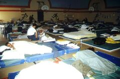 Stranded passenger start waking up on Thursday morning Sept. 13, 2001 in Gander, Nfld. in the gymnasium at Gander Academy, an elementary school. THE CANADIAN PRESS/Scott Cook